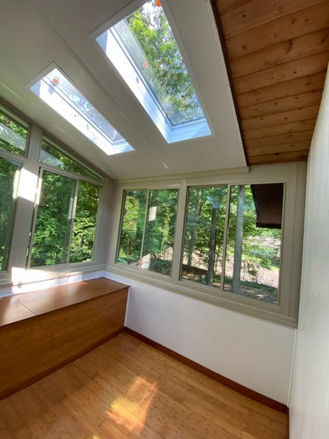 Sunroom interior with skylights